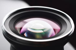 Camera lens. Close-up on gray and black background stock photo