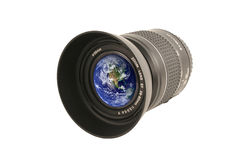 Camera lens with the earth in the glass Royalty Free Stock Images