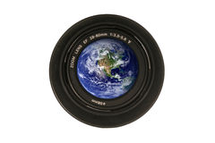 Camera lens with the earth in the glass Royalty Free Stock Photos