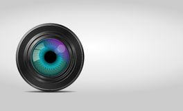 Camera lens. With eye on a light background royalty free illustration