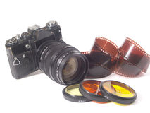 Camera,lens and film Royalty Free Stock Photos