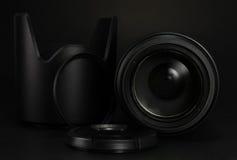Camera lens, filter, hood and lens cap Stock Photo