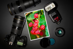 Camera lens and image on black background Royalty Free Stock Image