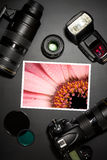 Camera lens and image on black background Royalty Free Stock Photo