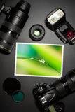 Camera lens and image on black background Royalty Free Stock Images