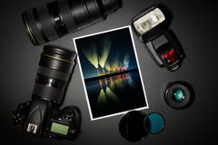 Camera lens and image on black background Royalty Free Stock Photography