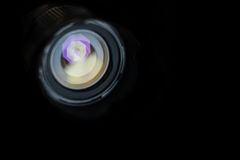 Camera lens with lense reflections on black Stock Photo