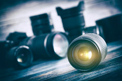 Camera lens with lense reflections. Professional Photography Lens Equipment Photographer Work Photo Lenses - Stock Image Stock Photo