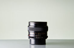 Camera Lens. A 35mm camera lens against a white background Royalty Free Stock Image