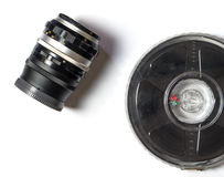 Camera Lens and movie Film strip Royalty Free Stock Photography