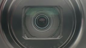 Camera lens opening. Close up of a compact camera lens opening stock footage