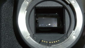 A camera lens opening the shutter stock footage