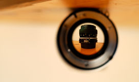 Camera lens perspective. A lens seen through another lens is upside down. The whole image is flipped to right the new image Stock Photography