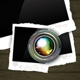 Camera lens with photos. Lens and photos in the background, this illustration may be useful as designer work Royalty Free Stock Photo