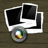 Camera lens with photos Stock Photo
