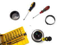 Camera lens repair flat lay view on white background Royalty Free Stock Image