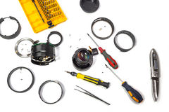 Camera lens repair flat lay view on white background Stock Images