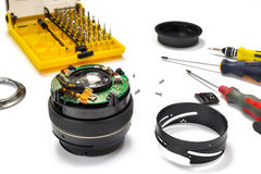 Camera lens repair on white background Royalty Free Stock Photo