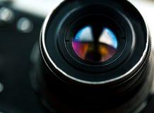 Camera lens. Retro stale. Royalty Free Stock Image