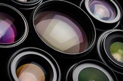 Camera lens. Set of camera lens different sizes and colors stock photos