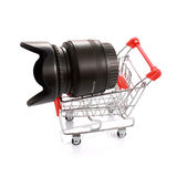 Camera lens in shopping cart isolated Royalty Free Stock Images