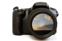 Camera lens sunset picture. A photo of a mountain sunset displayed in the camera lens Royalty Free Stock Photos