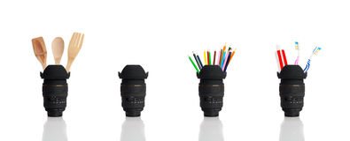 Camera lens various usages. Camera lens on white background with various utensiles in its inside Stock Photos