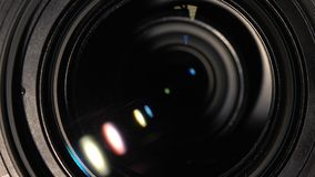 Camera lens zoom. Camera lens close up. Zooming process. Black video camera lens, showing zoom, photocamera or videocamera, close up, macro stock video footage