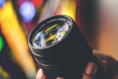 Camera lense and blurred background Royalty Free Stock Photos