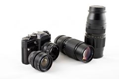Camera with lenses. A SLR camera with lenses lying near by Stock Photo