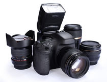 Camera and lenses. Details of a modern single reflex lens camera surrounded by several photographic lenses. White background Stock Images
