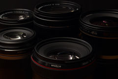 Camera Lenses. A small collection of high quality digital single lens reflex camera lenses photographed in low key Royalty Free Stock Photos