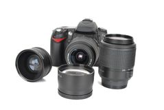 Camera and  lenses on the white. Stock Photography