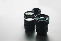 Camera lenses on a white surface Stock Photo