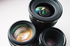 Camera lenses on a white surface Royalty Free Stock Photos