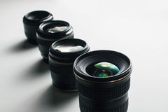 Camera lenses on a white surface Stock Images