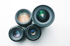 Camera lenses on a white surface Royalty Free Stock Image