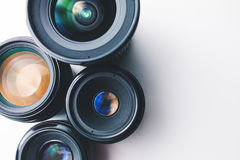 Camera lenses on a white surface Stock Photography
