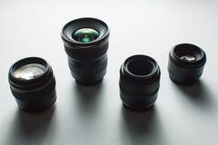 Camera lenses on a white surface Stock Photos