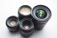Camera lenses on a white surface Royalty Free Stock Photography