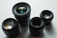 Camera lenses on a white surface Stock Image