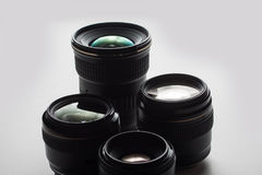 Camera lenses on a white surface Stock Photos