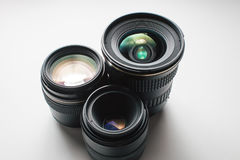Camera lenses on a white surface Royalty Free Stock Photo