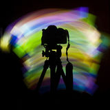 Camera Light. Light streaks and a camera silhouette Stock Photography