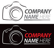 Camera Logo. A photography logo of a camera on an isolated or black background stock illustration