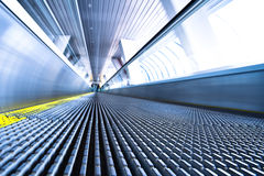 Camera is lying on escalator Royalty Free Stock Photo