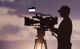 Camera man. Silhouette of a camera man stock photos