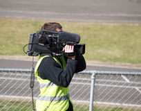 The Camera Man. A camera man videoing a sports event stock photography