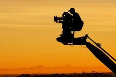 Camera man. On camera crane royalty free stock photo
