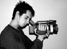 Camera man. Man filming with DV camera_grayscale photo Stock Images